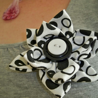 white and black fabric brooch