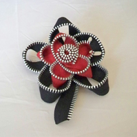 Black and red zip flower brooch