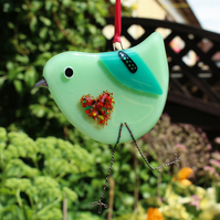 Mint green fused glass bird with love heart belly