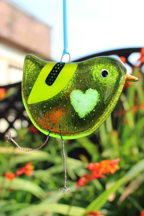 Green fused glass bird with white love heart belly