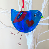 Blue fused glass bird with red heart belly
