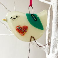Cream fused glass bird with speckled heart belly