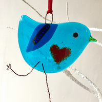 Blue fused glass bird with red love heart belly