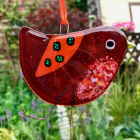 Orange fused glass bird