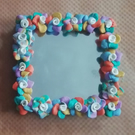 Clay rose mirror
