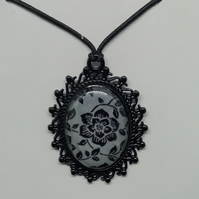 Rose patterned pendant