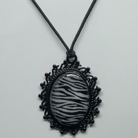 Zebra  patterned pendant