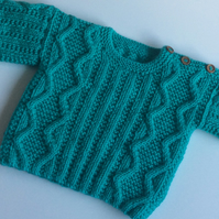 Hand knitted aran baby jumper