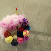 Pretty pompom and tulle or net wreath wall hanging