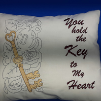 A lovely machine embroidered 'key to my heart' cushion
