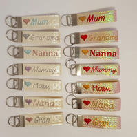 Machine embroidered mothers day faux leather and vinyl personalised  key rings.