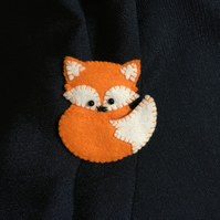 Orange felt fox brooch with contrasting stitching