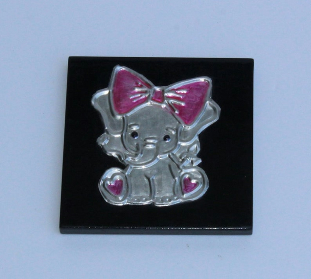 Hand embossed pewter elephant with a pink bow