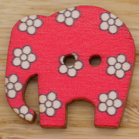 Red elephant with white flowers