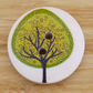 Yellow leaves on a green tree wooden buttons