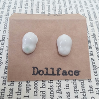 Dollface - odd pair - porcelain glazed studs, one with green underglaze