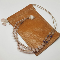 Rose quartz and leather pouch