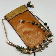 Nephrite jade, Paua shell and leather pouch.