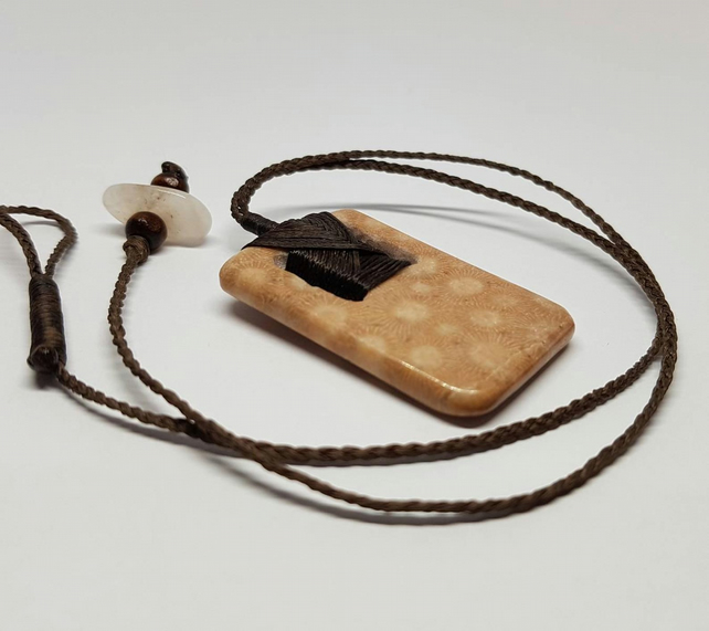 Indonesian fossilized coral toki pendant.