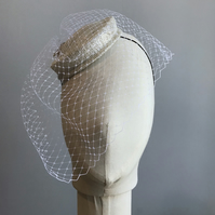 Silver white hat, with birdcage veil and 1950s style crystal cat decoration