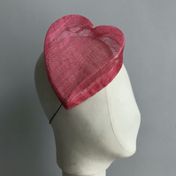 Pink heart-shaped percher hat