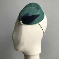 Turquoise percher hat with navy blue feathers and faux pearl beading