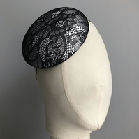 Black and white lace and satin percher hat.