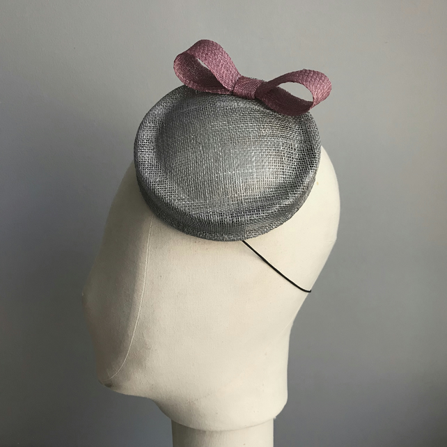 Silver sinamay percher hat with a dusky pink bow