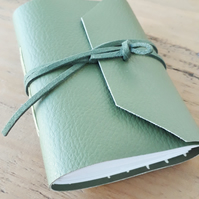 A7 Mini Notebook Faux Leather Wrap. 40 blank pages.