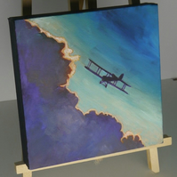 Skyscape of a silhoetted bi-plane called 'Silver Lining' by Nicola Crook