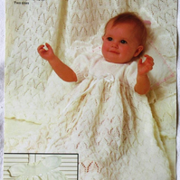 A knitting pattern for a baby's long or short lacy dress and shawl (Emu 8691)