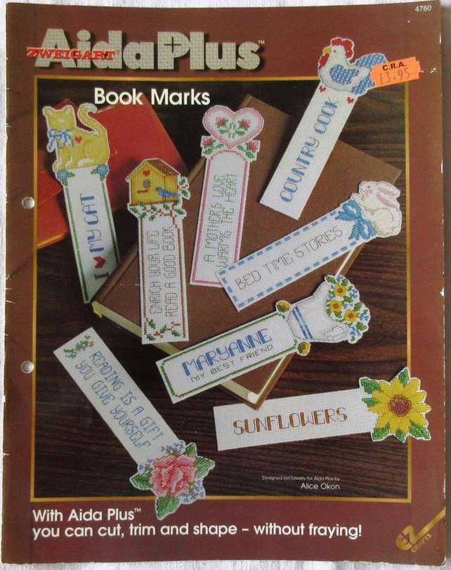 A booklet of cross stitch designs for bookmarks in Aida Plus fabric