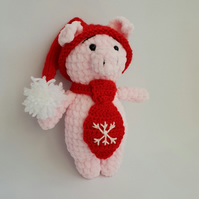 Handmade crochet piglet in a red hat