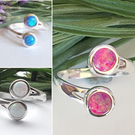 Modernist sterling silver and created opal swirl rings