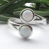 Modernist sterling silver and created opal swirl ring
