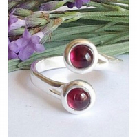 Modernist sterling silver and garnet gemstone swirl ring