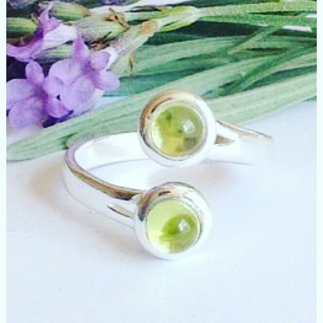 Modernist sterling silver and peridot gemstone ring
