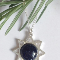 Striking sterling silver and blue goldstone sun necklace