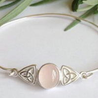Sterling silver and rose quartz Celtic knot bangle