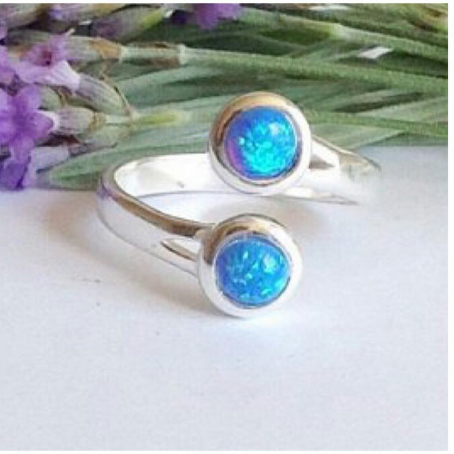 Modernist sterling silver and blue created opal swirl ring
