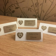 Personalised Place Card With A White Pearl Heart On A Gold Heart Wedding Table