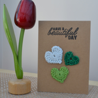 Greeting card with crochet hearts - No. 14