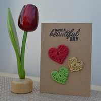 Greeting card with crochet hearts - No. 11