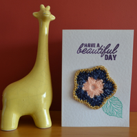 Greeting card with navy & gold crochet flower - No. 06