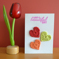 Greeting card with crochet hearts - No. 09