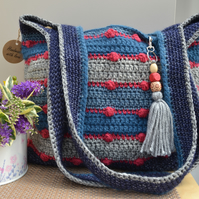 Delightful Blue & Grey Bag With Red Bobbles