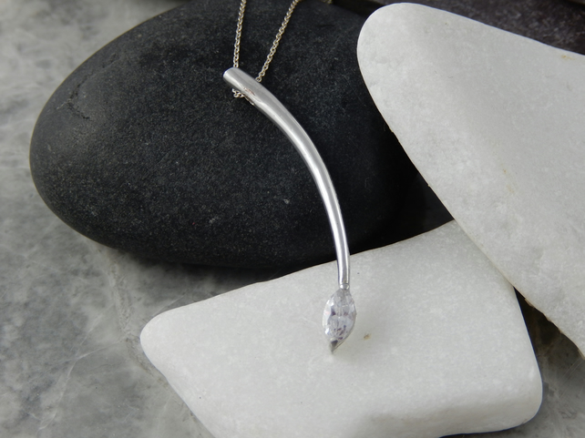 Silver curved bar pendant set with a Marquise Cubic Zirconia gemstone