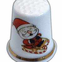 Personalised Fine Bone China Christmas Comic Santa Thimble, Personalised Thimble