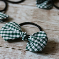 Pony tail hair bands with fabric bows made using green gingham