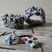 Multi color retro print scrunchies and a ponytail hair tie with a fabric bow